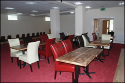 Photograph of the social club interior, showing the big screen